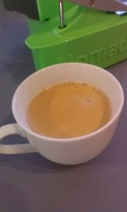 The finished cup of coffee. No milk in it yet - that's just the crema you can see.