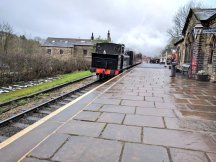 A classic steam train approaching Oakworth station