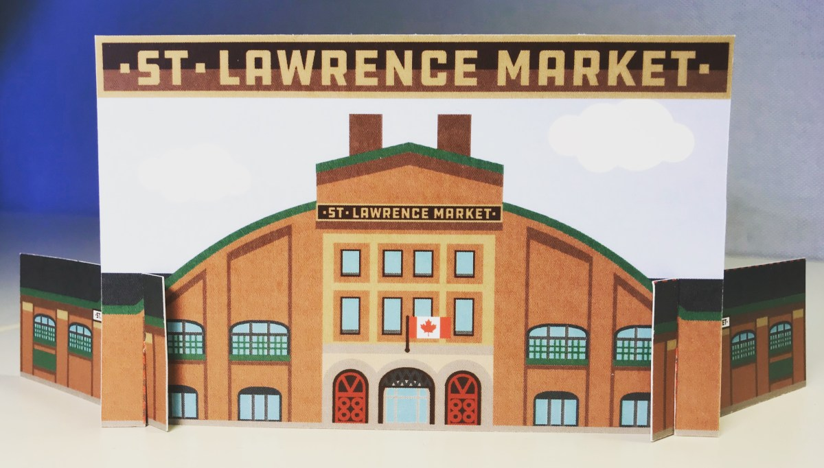 A cardboard cutout of the facade of St. Lawrence Market