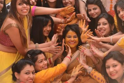 squad photos at your haldi witty vows, wedding pictures | Indian bride with her bridesmaids at her haldi