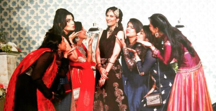 the one where they shower the bride with affection | Indian bride with her bridesmaids posing at the Sufi night | wedding pictures