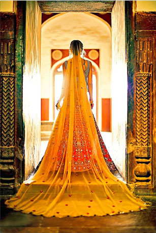 Trend Alert - Bridal Train for the Indian Bride   Curated by Witty Vows   Let your dupatta make a train to die for pale dupatta with red and green lehenghaTrend Alert - Trains for the Indian Bride   Curated by Witty Vows   Let your dupatta make a train to die for pale dupatta with red and green lehengha