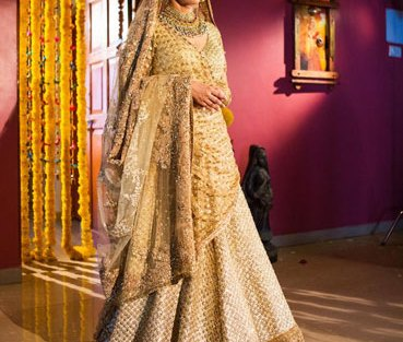 All gold and creme sabyasachi lehenga with shimmer work all over and a broad gold border
