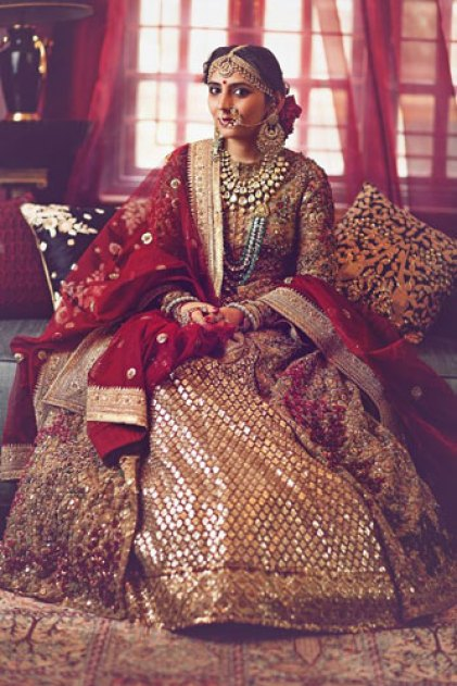 Maroon Sabyasachi lehenga with all over trademark sabyasachi paired with a net maroon dupatta