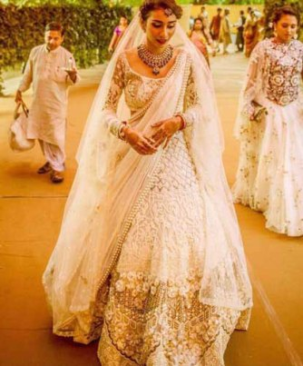 A gold and white stunning lehenga for the day wedding with lace and embroidery mix | Curated by Witty Vows