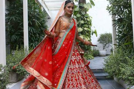beautiful classic red gottapatti anita dongre lehengha with red dupatta and orange and gold choli. Don't miss the teal and orange pasting detail on the dupatta   Curated by Witty Vows