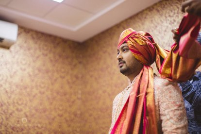 Outfit ideas for the Indian Groom | Light Pink sherwani with a pink and mustard Saafa | Into candid Photography | Curated by Witty Vows