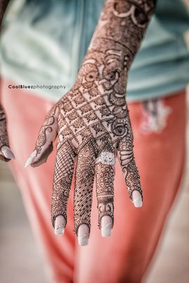 Things you simply must do 3 months before the wedding for every Indian Bride - Ring selfie french manicure on henna hand | Witty Vows