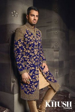 Prussian blue sherwani with a beige kurta and gold embroidery | Image Kush Magazine | Curated by Witty Vows