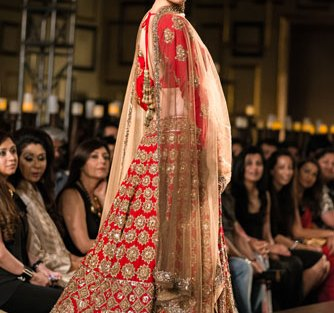Red and gold pretty bridal lehenga with heavy embellishment all over work and gold dupatta in gold by Manish Malhotra | Worn by Alia Bhat | curated by witty vows