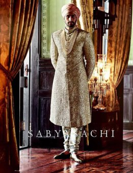 Fashion for the Indian Groom | Ideas for Wedding Sherwani Designs for Men |All Gold sherwani with a soft serenity pink pagadi saafa| Sabyasachi Groom | Curated by Witty Vows