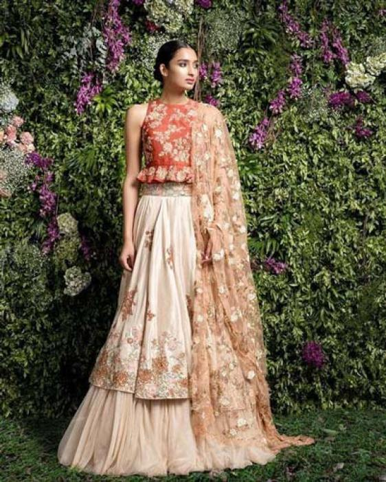 Day Wedding Lehenga Style | Creme double layer lehenga with gold detailing, orange peplum blouse with gold embroidery and pretty net peach dupatta with allover gold embroidery | Shyamal Bhumika | Curated by Witty Vows