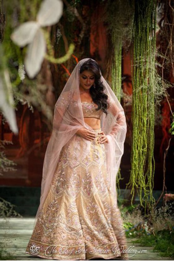 Day Wedding Lehenga Style | Chitrangada Singh | Dull yellow gold and light pink Lehenga with allover embroidery, pink net dupatta | Tarun Tahiliani | Curated by Witty Vows