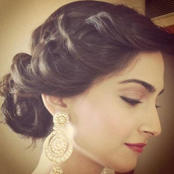 Indian wedding hairstyles for Indian Brides | Soft twisted side style with curled bun