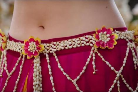 Yellow red and jasmine flower waist belt | Kamarband for the Indian Bride on her Mehndi & wedding | Image from bahubali the film | Curated by witty Vows