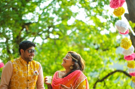 The chilled out Indian Bride in yellow and pink anarkali for her mehendi with a minimal mathapatti | Jonathan & Subhashree | Hill station outdoor colourful mehendi | Groom's Name in the mehendi | Curated by Witty Vows
