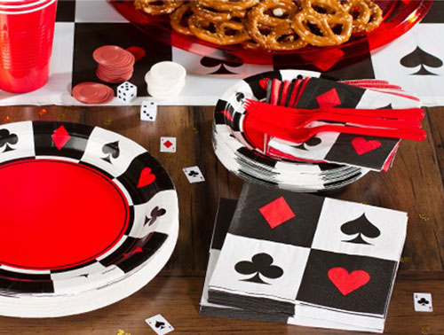 Printed plates and napkins for a playing cards diwali party   Decor ideas for your first diwali cards party together after marriage at home   Curated by Witty Vows