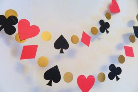 Strings of playing card suits hanging as DIY decor for your first diwali cards party at home