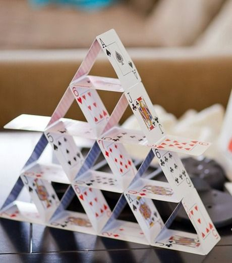 Make a house of cards by gluing cards together for a DIY centrepiece and decor idea for your house diwali party   curated by Witty Vows
