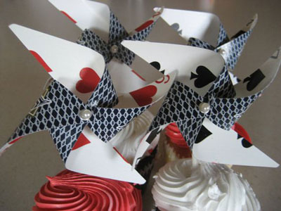 Make pinwheels from playing cards and ad a cute little pearl in the center! Curated by witty vows