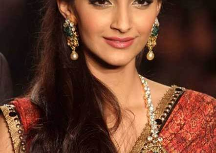 Indian wedding hairstyles for Indian Brides | Sonam Kapoor sports loose natural waves with side braides