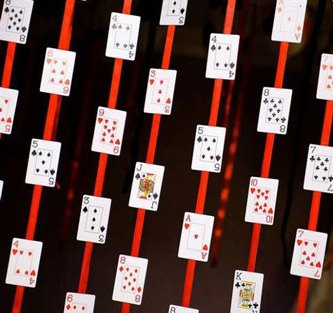 Strings of playing cards hanging as DIY decor for your first diwali cards party at home | curated by Witty vows | Decor Ideas for a diwali party at home