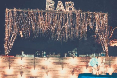 Ideas for an intimate night cocktail party for Indian weddings | Outdoor decor ideas for Indian weddings | Fairy light and twig and dry decor | Light up bar signage | Jonathan and subhasheree | Rustic woodland destination wedding | Curated by Witty Vows