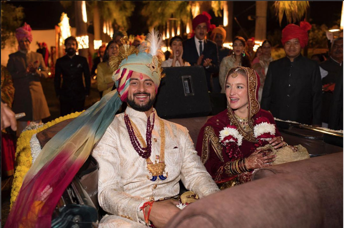 Actor Aurunoday Singh's wedding to Lee Elton in Bhopal   The couple exit in a Vintage car   Groom in white sherwani with a multicolour saafa