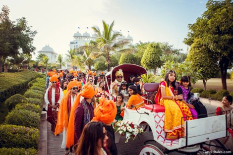 Indian groom entry ideas | Groom enters in on a golf cart | Curated by witty vows
