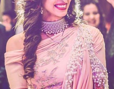 Indian Wedding Ideas from Suyyash and Kishwer's Wedding Reception   Kishtwar in a peach & silver lehenga and suyyash in a white tux   peach of shoulder lehenga with pearl detailing