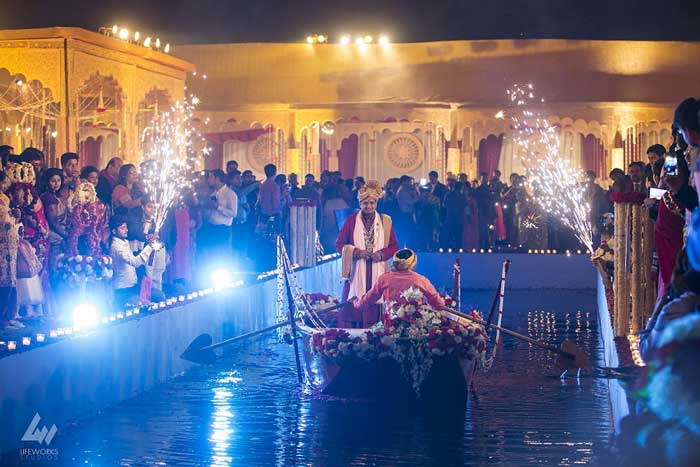 Indian groom entry ideas | Looking dapper on water in a boat |Curated by witty vows