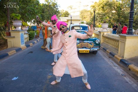 Indian groom entry ideas | Groom enters in a vintage car with a golden moustache on it | Dream Diaries | Curated by witty vows