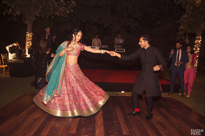 New Indian wedding ideas from VJ Yudi and Aditis Pretty Wedding   VJ Yudi and Aditi wedding in Delhi   Celebrity wedding ideas   Aditi in a pretty red and green lehenga and dupatta with kind strings and Yudi in a charming black bandhgala and red socks