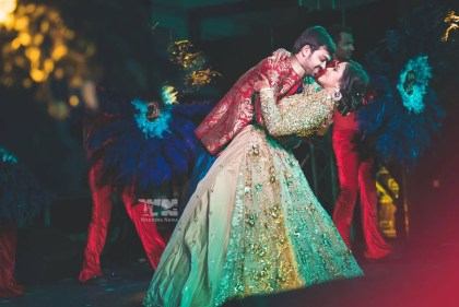 Sangeet Songs | New Indian Wedding Songs to dance on | The best of 2017 Couple dance songs for the Sangeet | Photo by Wedding Nama | Witty Vows | Indain bride and groom dancing at the sangeet cocktail night | Golden gown with embroidery detailing