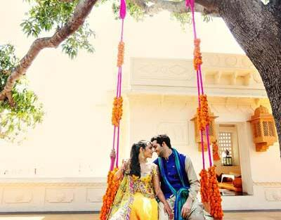 Mehndi jhoola and innovative mehndi decor ideas | beautiful mehndi swing bridal seat idea with bride in ombre lehengas | Photo by whitebox Studio