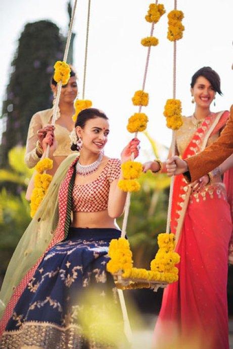 Mehndi jhoola and innovative mehndi decor ideas | beautiful mehndi swing bridal seat idea with Bride on rope swing | Vogue Wedding Show