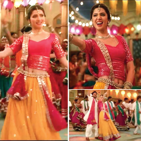 Mahira Khan in a pink and yellow lehenga blouse combination in Raees in Udi Udi Jaye | Paired with a narrow dupatta with a gold border and a gold beaded waist belt | Bollywood fashion | Wedding Lehengas | bollywood lehenga | designer lehenga