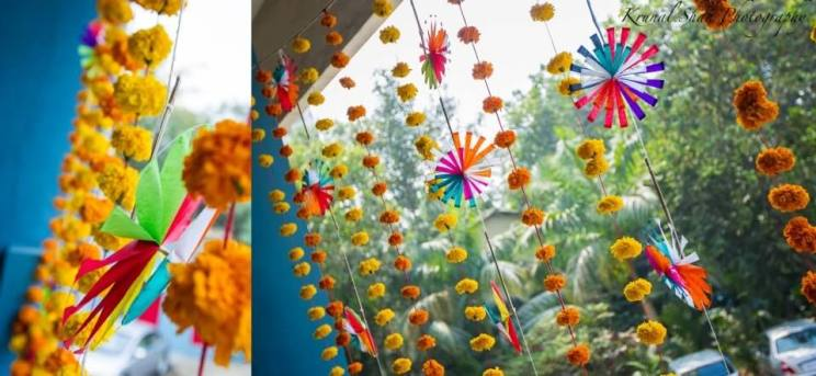Indian Kitsch Mehndi Decor Ideas | Fun DIY Mehndi theme with super colourful Mehendi decor | Witty Vows | Colourful marigold flower strings with paper pinwheel hangings | Komal shah photography
