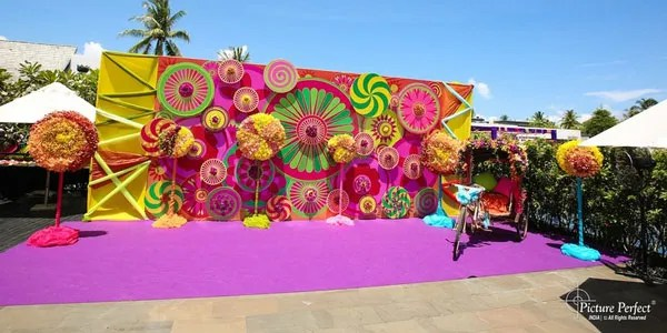 Indian Kitsch Mehndi Decor Ideas | Fun DIY Mehndi theme with super colourful Mehendi decor | Witty Vows | Colourful flex stage with marigold 3d decor