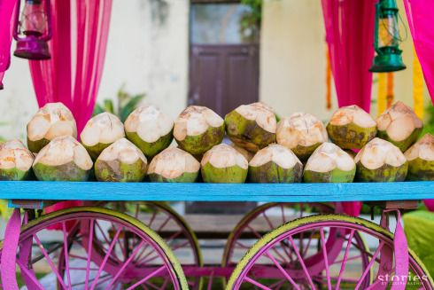 Wedding Caterer selection | Indian Wedding Food Ideas | Advice from the best caterers in Delhi | Kitschy fun decor for Indian Wedding | Colourful coconut water bar | Photo by Stories by Joseph Radhik | Mehndi food ideas | Cart bar
