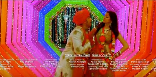decor ideas from bollywood film Band Baaja Baraat | bollywood wedding | fun diy mehndi decor ideas | colourful bulb backdrop | colourful decor for Indian mehndi | colourful bulb sequin and kitsch mehndi decor | Kitsch passage decor