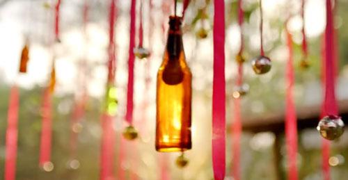 decor ideas from bollywood film Baar Baar Dekho | bollywood wedding | fun diy mehndi decor ideas | pink hanging ribbons shimmer silver balls | colourful bottles