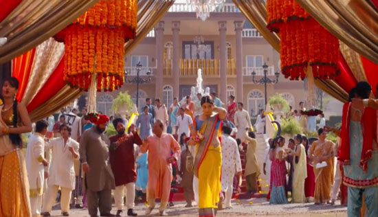 decor ideas from bollywood film 2 states | bollywood wedding | fun diy mehndi decor ideas | Iski Uski | colourful decor for Indian mehndi | marigold flower chandelier with pom pom ends and flower tassels