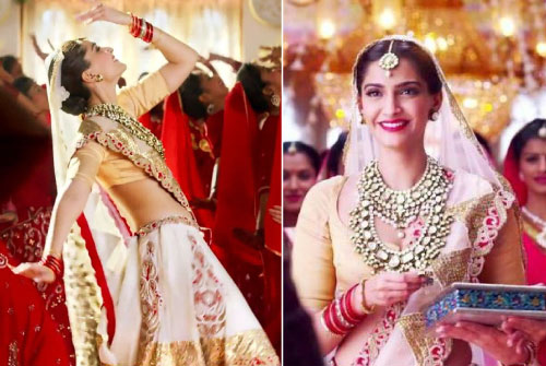 Sonam Kapoor wedding look in Prem Ratan than payo in a pretty light pink lehengas with red and gold floral motifs and a beige plain blouse with beautiful Kundan bridal jewellery | Bollywood fashion | Wedding Lehengas | bollywood lehenga | designer lehenga