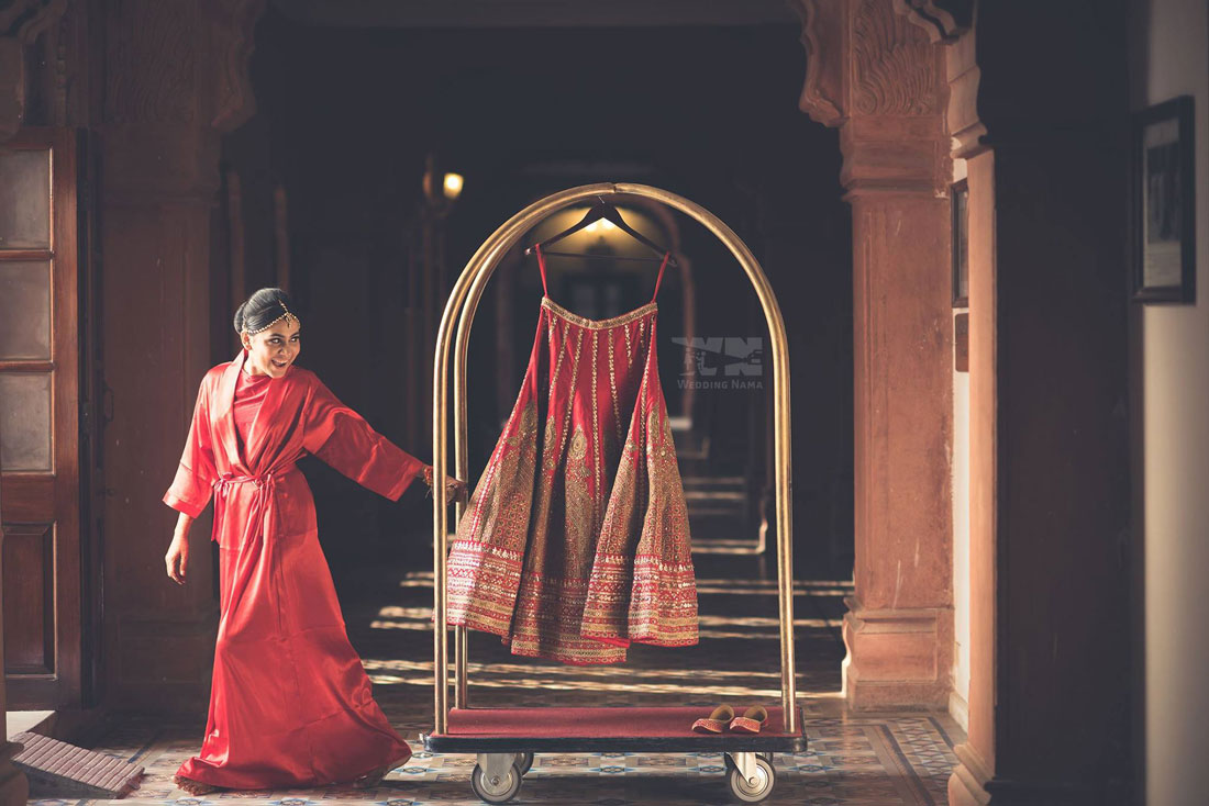 Indian wedding rentals | Luxury services on rent | Fashion on rent in India |vintage cars on rent, helicopter on rent, Pre wedding shoot locations | Bridal outfits on rent | Bride getting ready | Red and gold sabyasachi lehenga | Wedding Nama