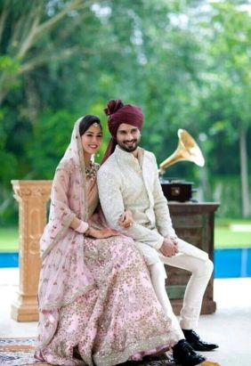 Coordinated outfits, Tips for Couple outfits | Bride Meera ragout wears a pink lehenga and groom shahid Kapoor wearing a deep Burgundy matching saafa | Bollywood Wedding Style you'll have as per Horoscope