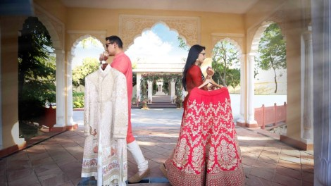 Coordinated outfits, Tips for Couple outfits | bride carrying Red and gold lehenga and groom carrying an ivory and gold sherwani