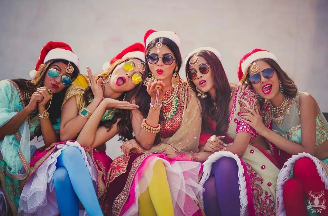 Indian bridesmaids duties | Bride's friends | BFF photos from Indian wedding | Indian bride with her bridesmaids wearing reflective sunglasses | Morvi Images