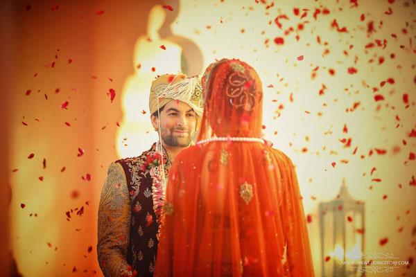 Neil Nitin mukesh's wedding photo with a flower shower