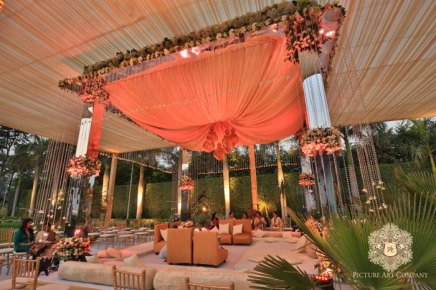 Ridhi Mehra's wedding photos | Ivory and mirror mandap with floral decor